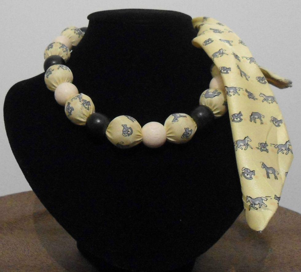 cravatta cerchietto, cravatta foulard, cravatta fascia, cravatta collana, cravatta cintura, cravatta gialla